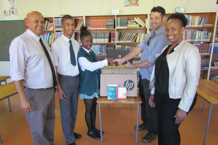 Image of Geosense handing over laptops to local school in South Africa